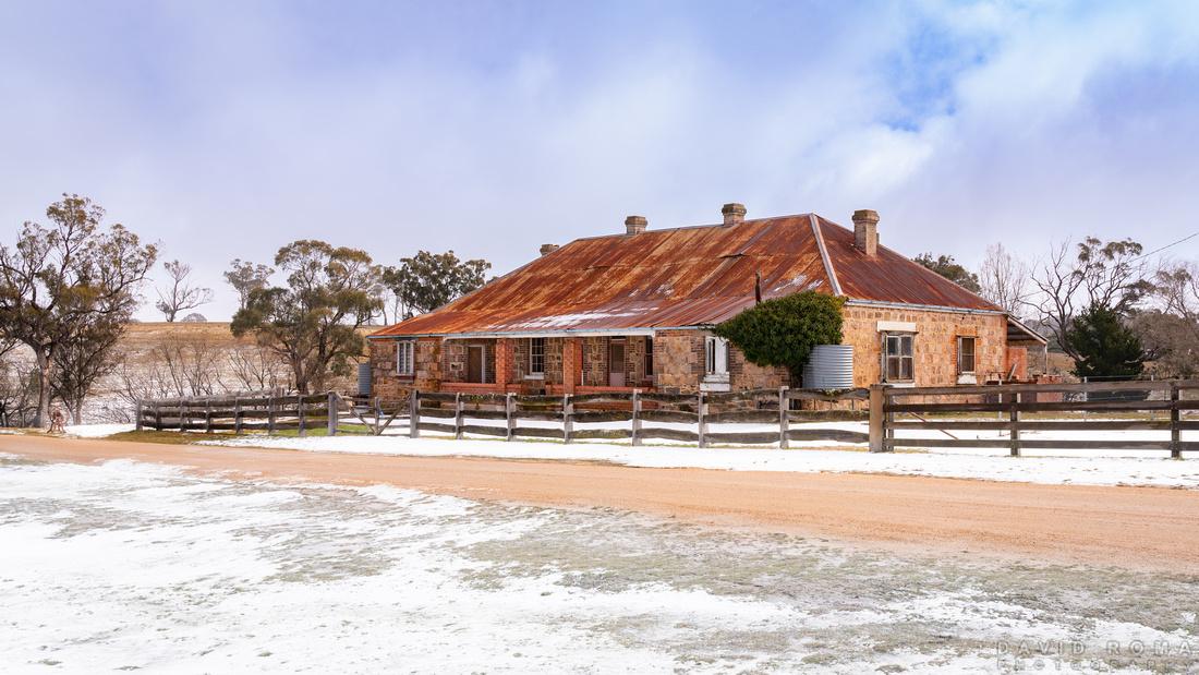 Snow melting on old Inn